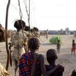 Children watch Dassanech Dimi
