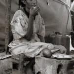 Woman drinking coffee - Kotobia Camp, Ethiopia