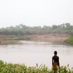Karo woman looks over the Omo River