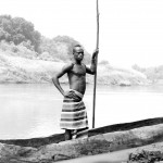 Kwegu man with dugout canoe on the Omo River