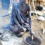 Mursi woman prepares coffee beans