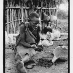 Old Mursi Woman Prepares Coffee