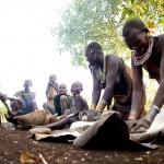 Surma family grinding maize 2