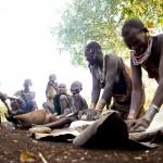Surma family grinding maize 2