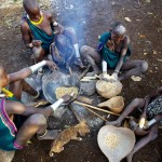 Surma family cleaning and heating maize