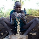 Surma girl cleans the maize 2