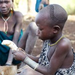 Young Surma girl with plantain