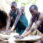 Surma women grinding maize