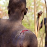 Mursi Boy with whip cut after Terro Donga