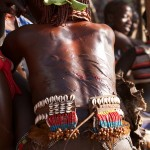 Hamar woman with whip marks at bull jumping
