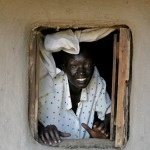 Woman at the window, Western Kenya