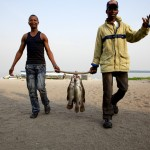 Two Kome Island fisherman return from their boat with their catch