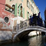 Venice Carnival Characters on a bridge