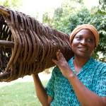 Catherine Nanjala with beehive, Neema Women's Group, Kamasielo Village, Kenya