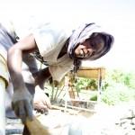 Mine Worker sifts through rubble, Migori Gold Mine, Kenya